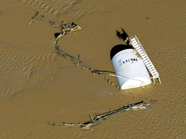 Produced Wastewater Tank Overturned By Floodwaters © John Wark